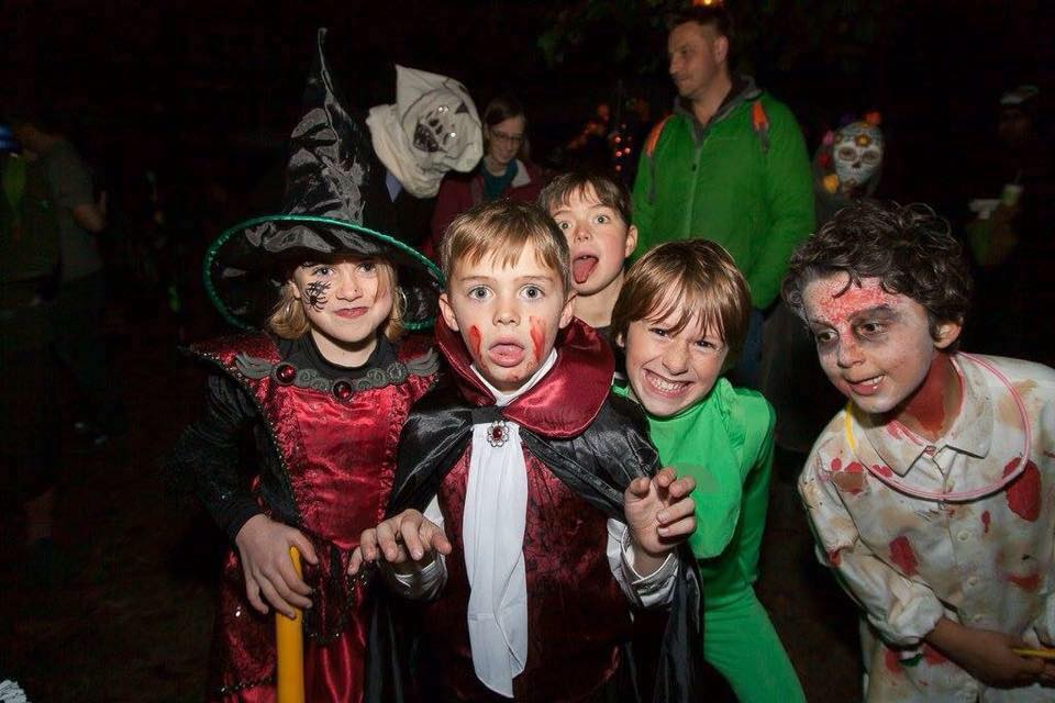 Green Halloween family protest on Tonbridge river bank