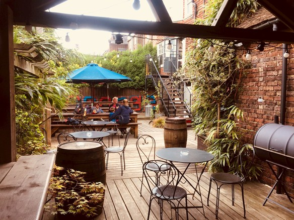 The George has a secluded, relaxed beer garden to enjoy.