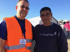 HELPING HANDS Dr Greco with Ahmed from Aleppo